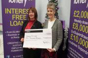 CHRISTMAS CHEER: Pictured receiving her cheque for £10,000, Amanda McCabe (left) from Narberth. PICTURE: Western Telegraph