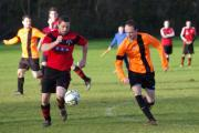 RED HOT ROBINS: Pennar's Richard Hughes and Johnston's Ryan Doyle jostle for possession. PICTURE: Western Telegraph. (14639594)