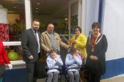 Sisters Molly and Emily, with their parents Sarah and James, are pictured at the opening of Tenby's new Ty Hafan shop with the mayor of Tenby, Councillor Sue Lane and Matt Williams, the charity's retail general manager. (20801224)