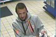 Police image of man they want to speak to in relation an investigation into Tesco tobacco theft (24389298)