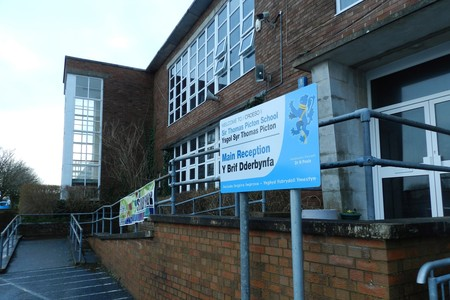 Sir Thomas Picton School has been removed from special measures by Estyn