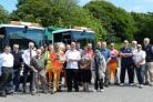 Brian Reynolds (centre, front row) pictured at the ceremony celebrating his 48 years as a local bin man. PICTURE: Western Telegraph  (29684535)