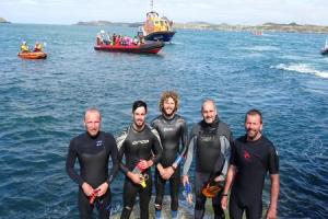 Lifeboat station fundraising swimmers brave Ramsey Sound