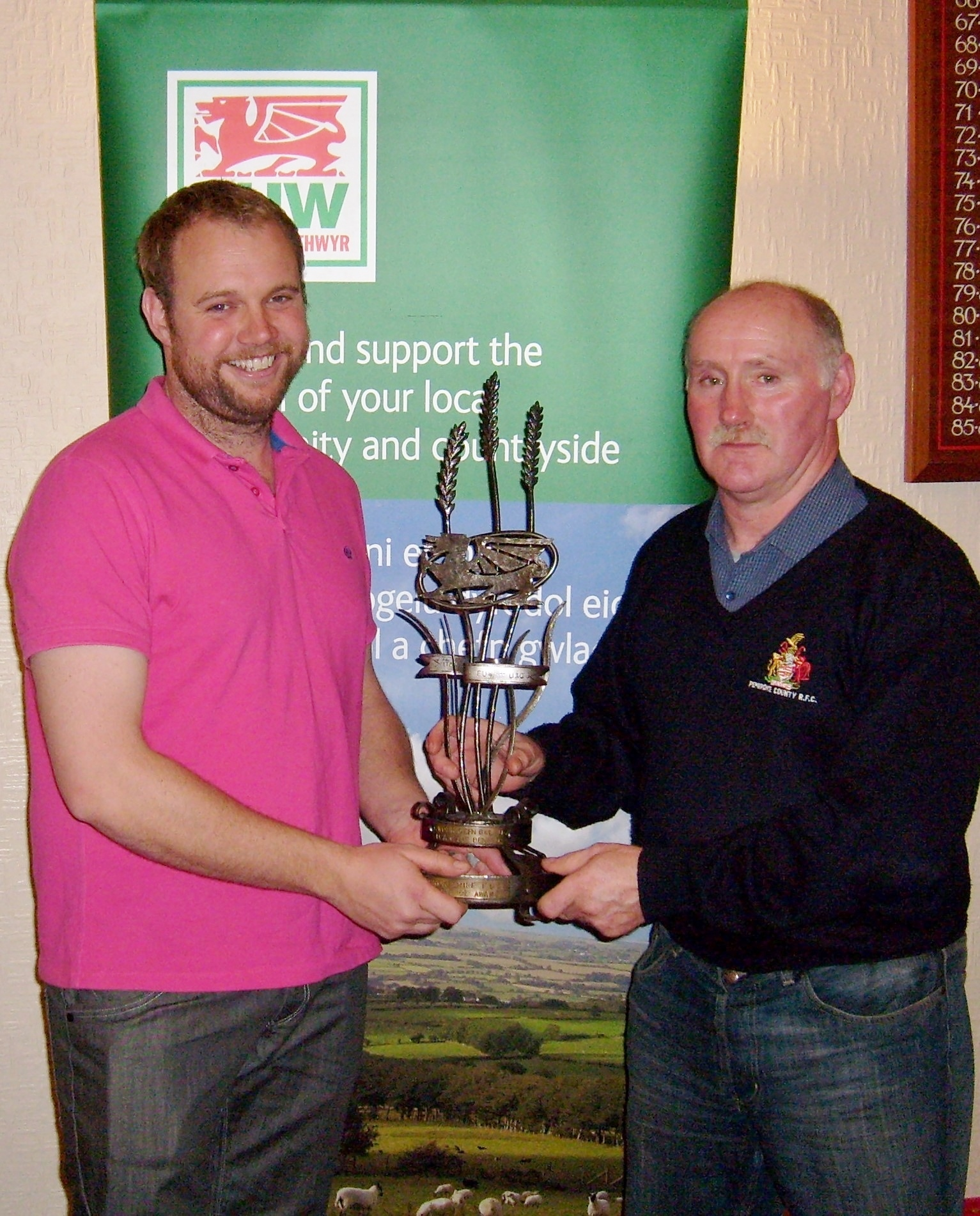 Mathew Williams receives the Pembrokeshire FUW Countryside Business award from FUW Pembrokeshire county chairman Hywel Vaughan (48380009)