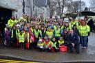 Narberth CP School pupils, parents and teachers are pictured on their Road Safety Week walk. They are accompanied by road safety staff, a local PCSO, Cllr Huw George, cabinet member for the environment, and Cllr Wynne Evans, chairman of Pembrokeshire Coun