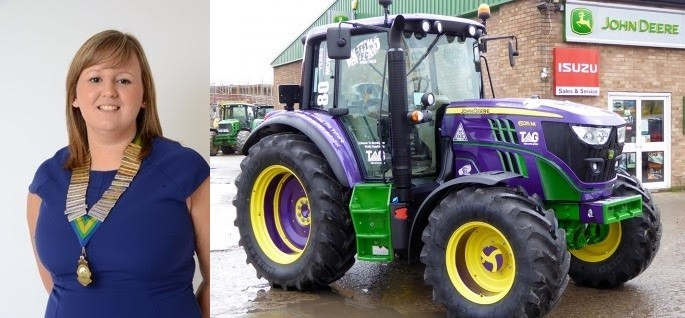 Wales YFC Chairman Vicky Hope and the purple John Deere tractor supplied by Tallis Amos Group.  (52901834)