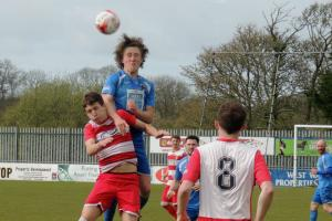 Greg Walters wins a header against Caldicot.