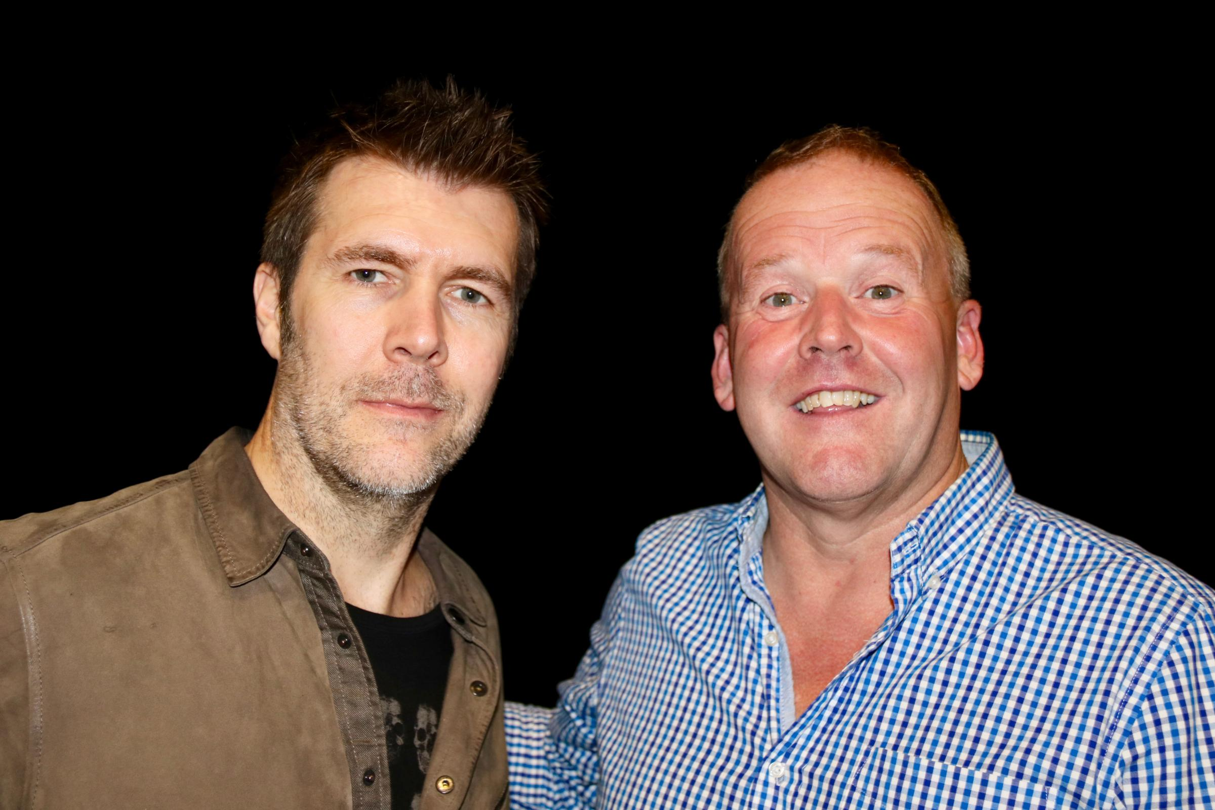 Rhod Gilbert and old school pal Anthony Mattick are teaming up to organise Saturday's charity comedy quiz.