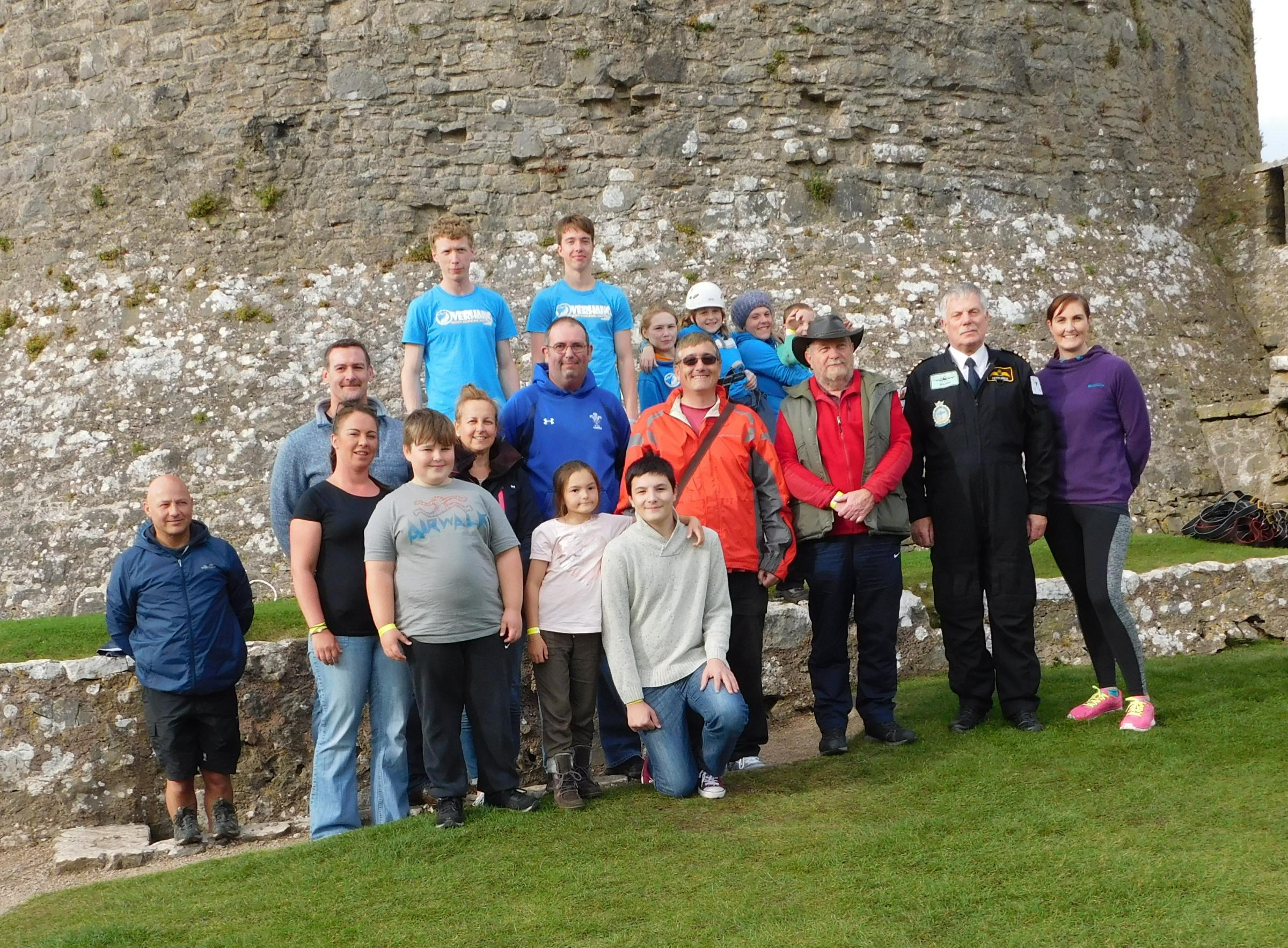 The team raising funds for a community minibus for Pennar at pictured at the based of Pembroke Castle's keep.