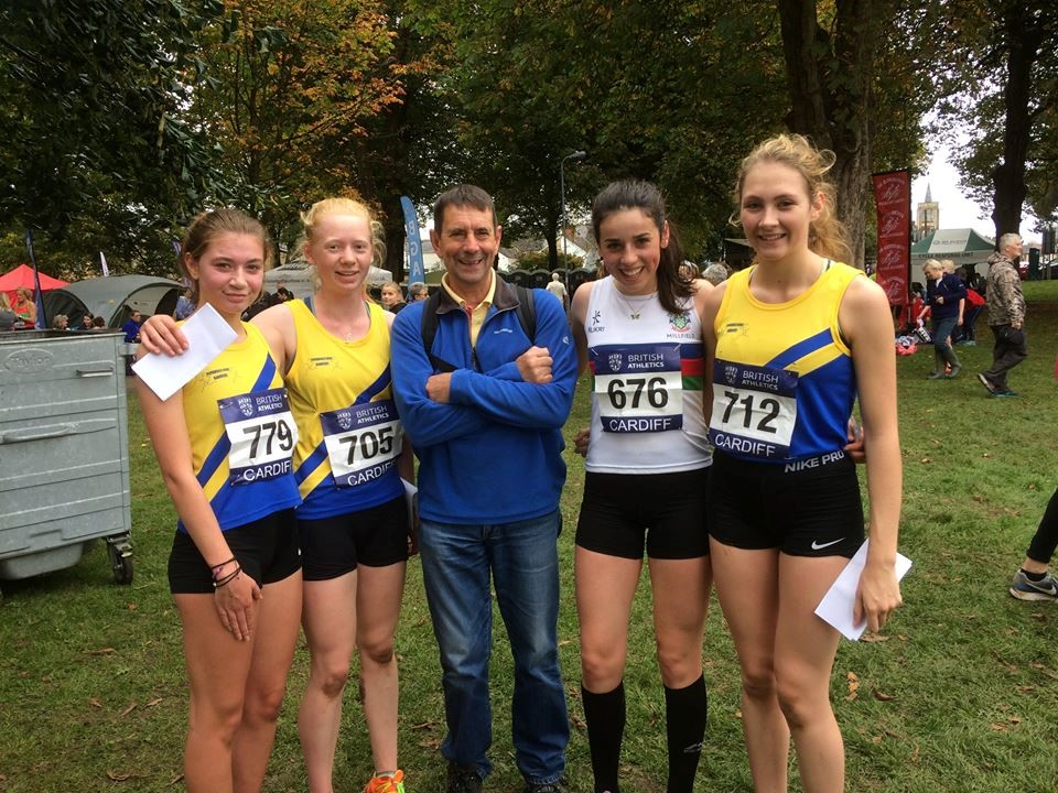Alice Evans, Eliza Martin, Lucy Davies, and Lucy Omnet, with Coach Peter Freeman.