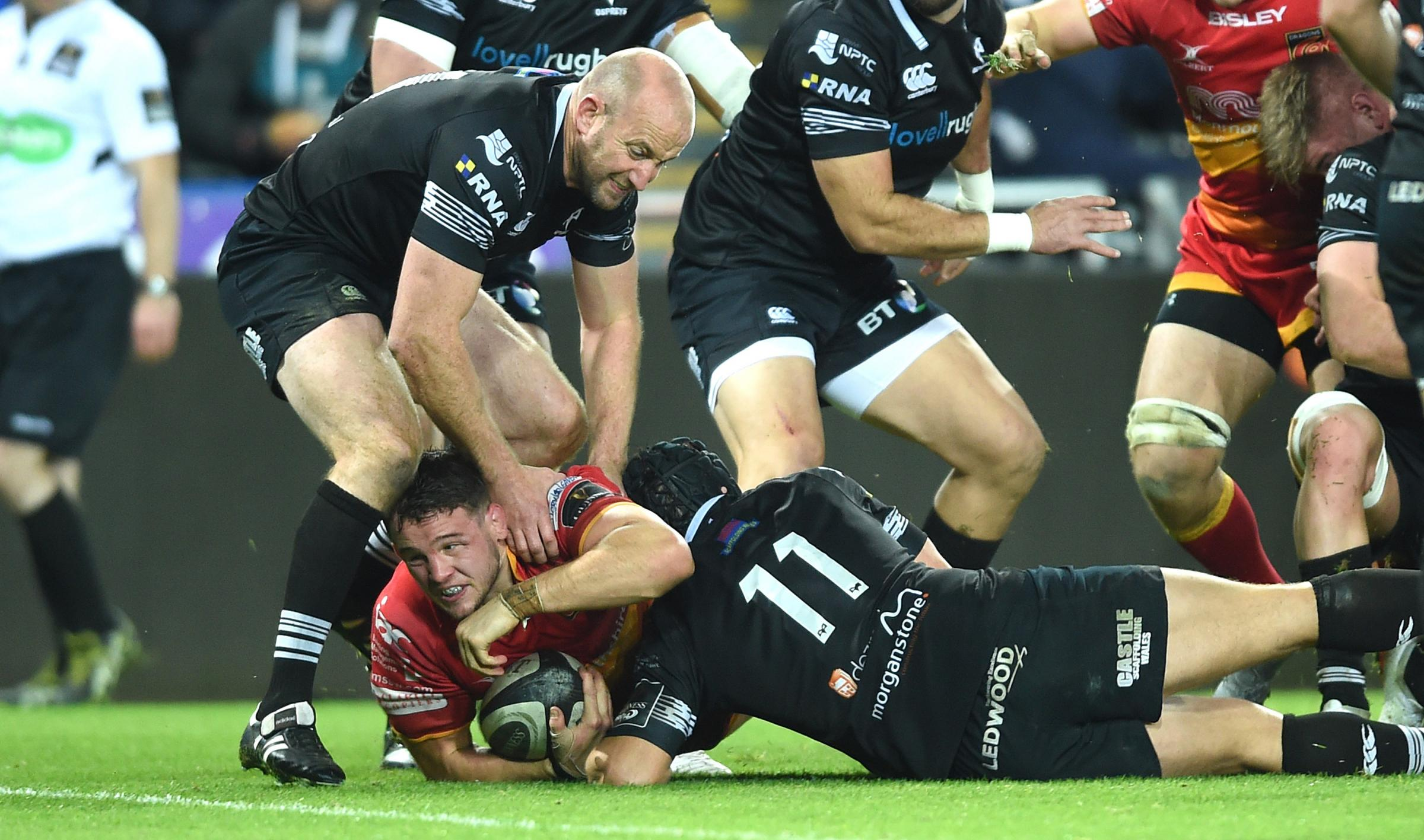 NEW DEAL: Hooker Elliot Dee, pictured scoring his fifth try of the season at the Ospreys, has signed a new three-year Dragons contract
