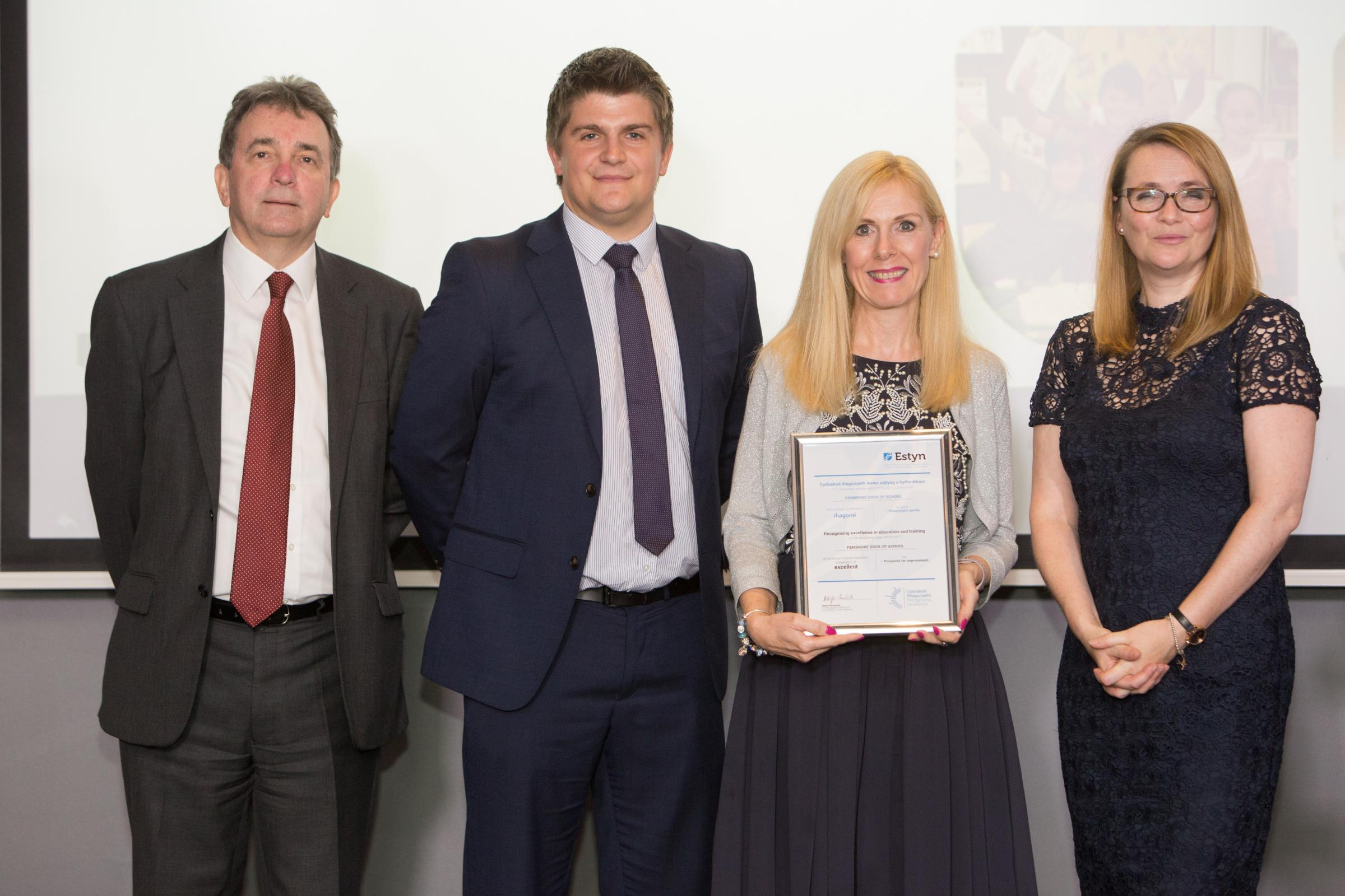 Pembroke Dock Community School Head teacher Michele Thomas Thomas (second from right) is pictured with the certificate alongside Deputy Head Stefan Jenkins, They are flanked by Mr Rowlands and Mrs Kirsty Williams.