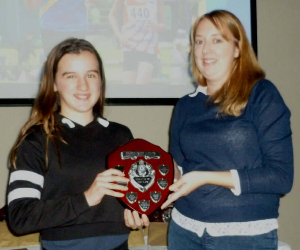 Ella receiving her Pembrokeshire Harriers' award from Kelly Griffiths.