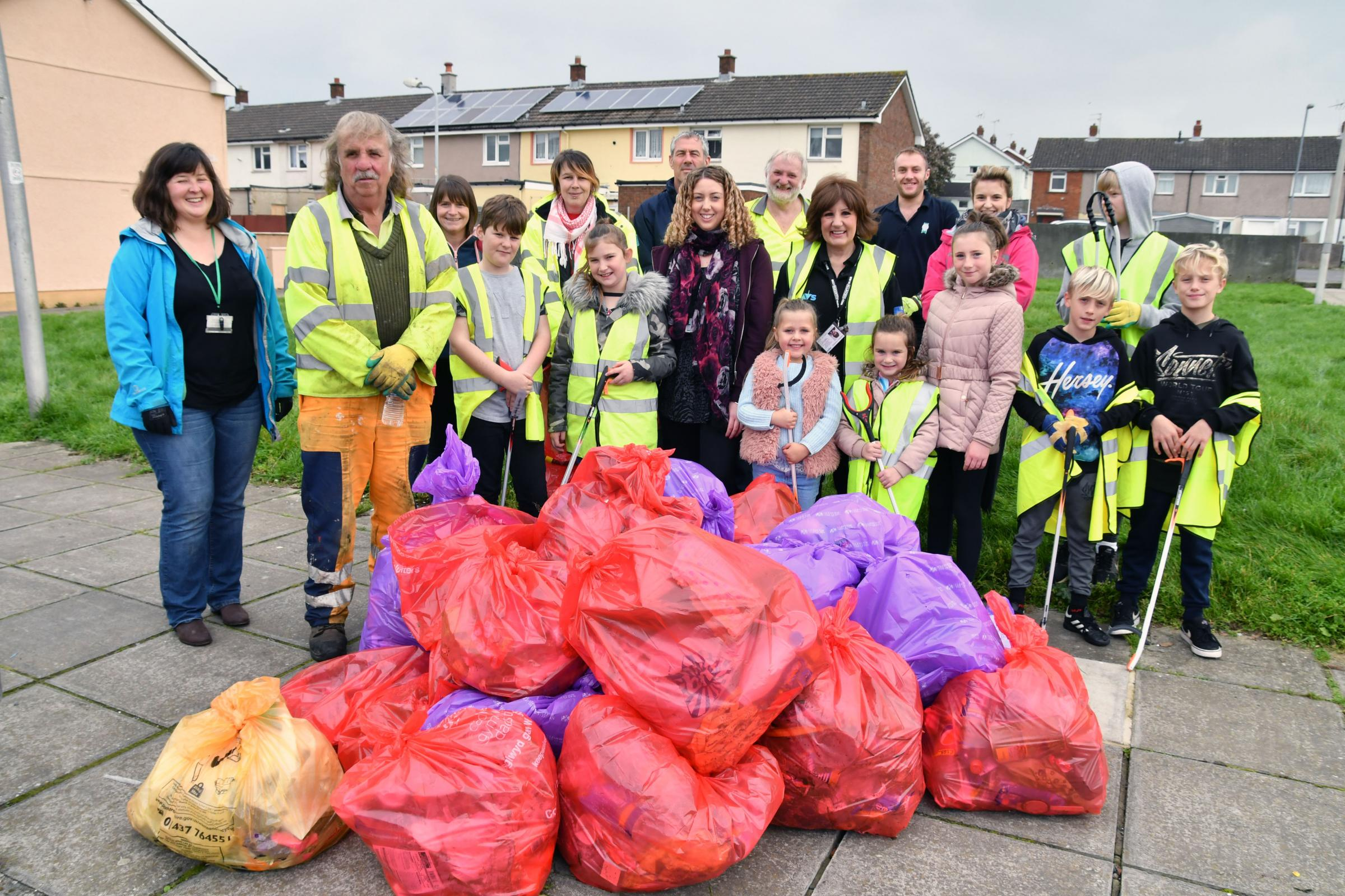 Residents were among those who helped clean-up Monkton estate. With them are several bags of recyclable material awaiting collection.