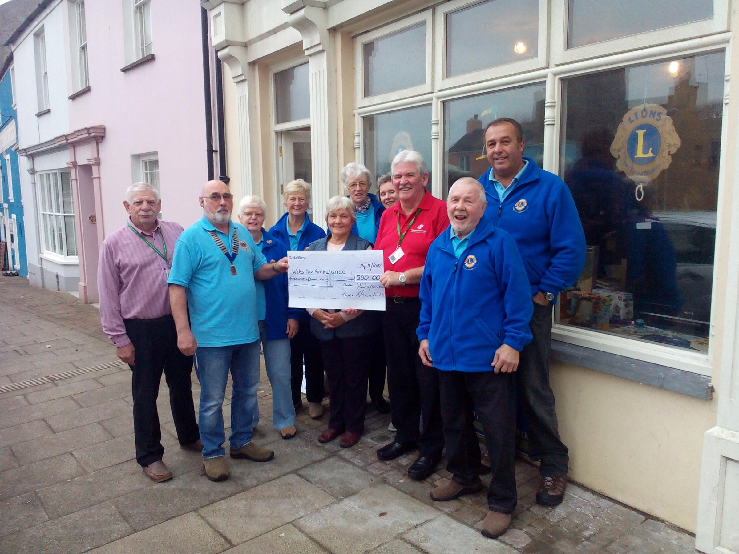 Pembroke and Pembroke Dock Lions President Peter Deponeo is pictured presenting a cheque for £500 to Wales Air Ambulance representative Tony Key OBE.