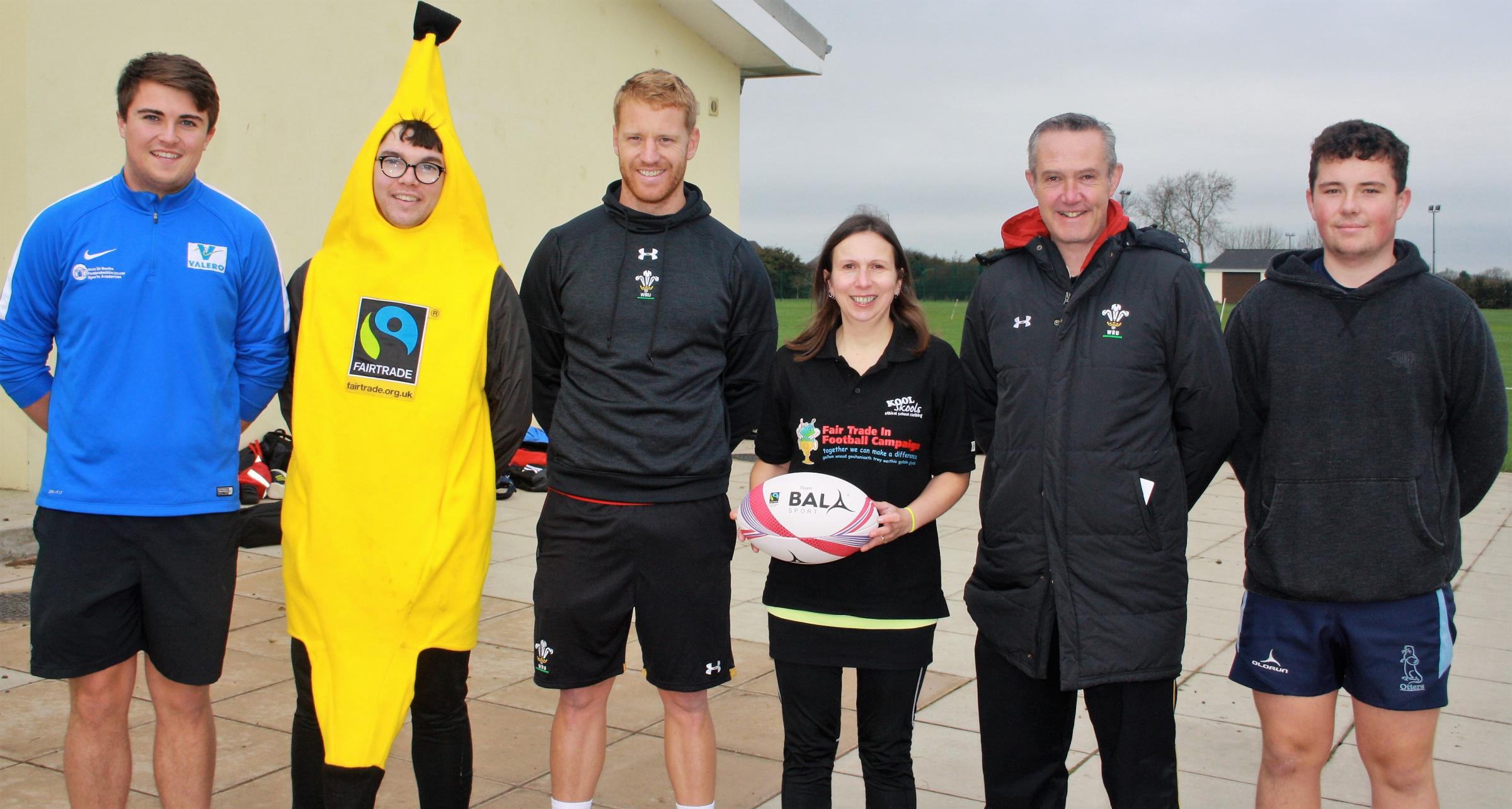 Lloyd Phillips and Mike King of the WRU, joined by Sharron Hardwick and festival volunteers and referees.