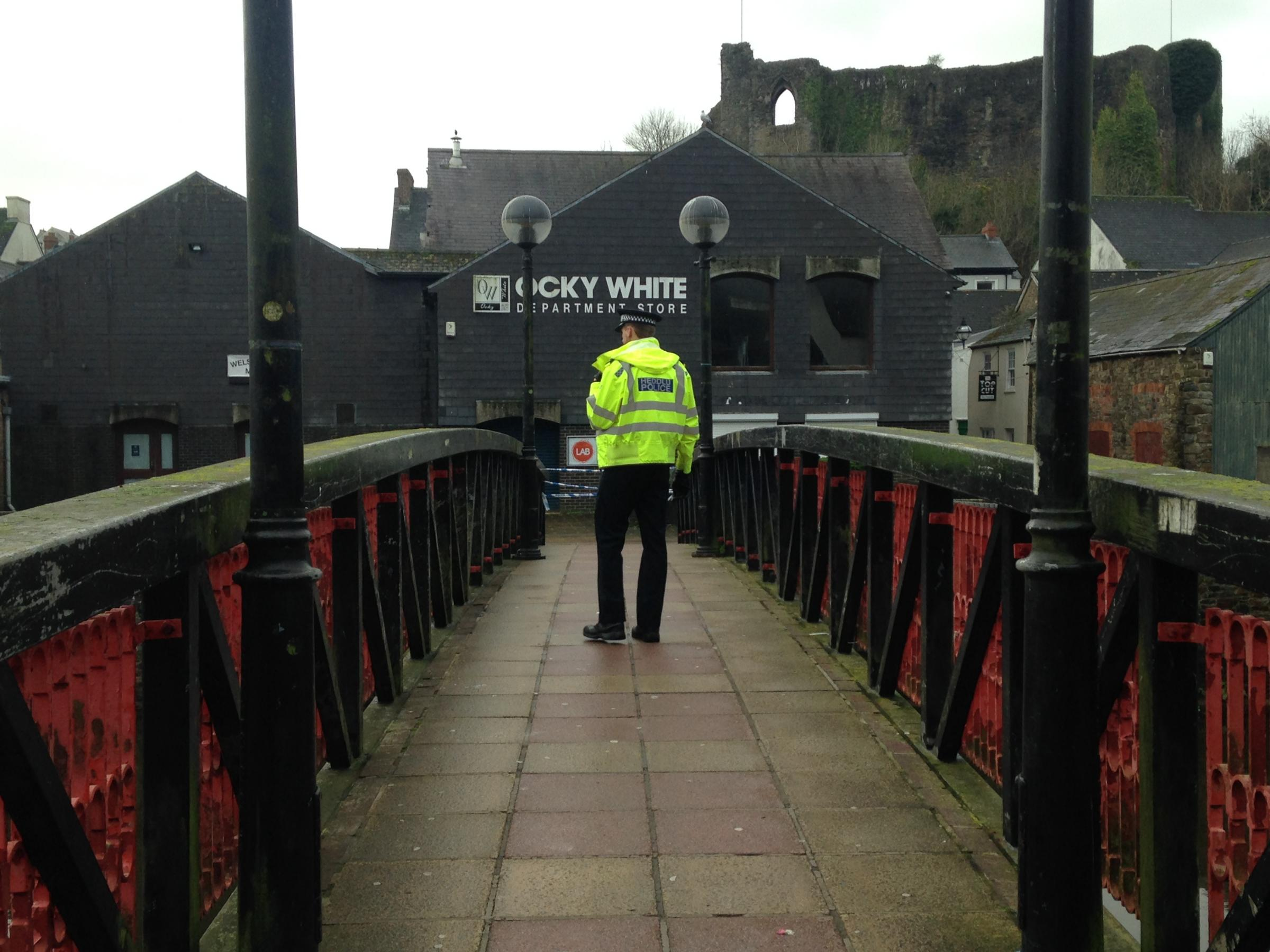 A police officer patrols the footbridge in Haverfordwest on Sunday, December 3.