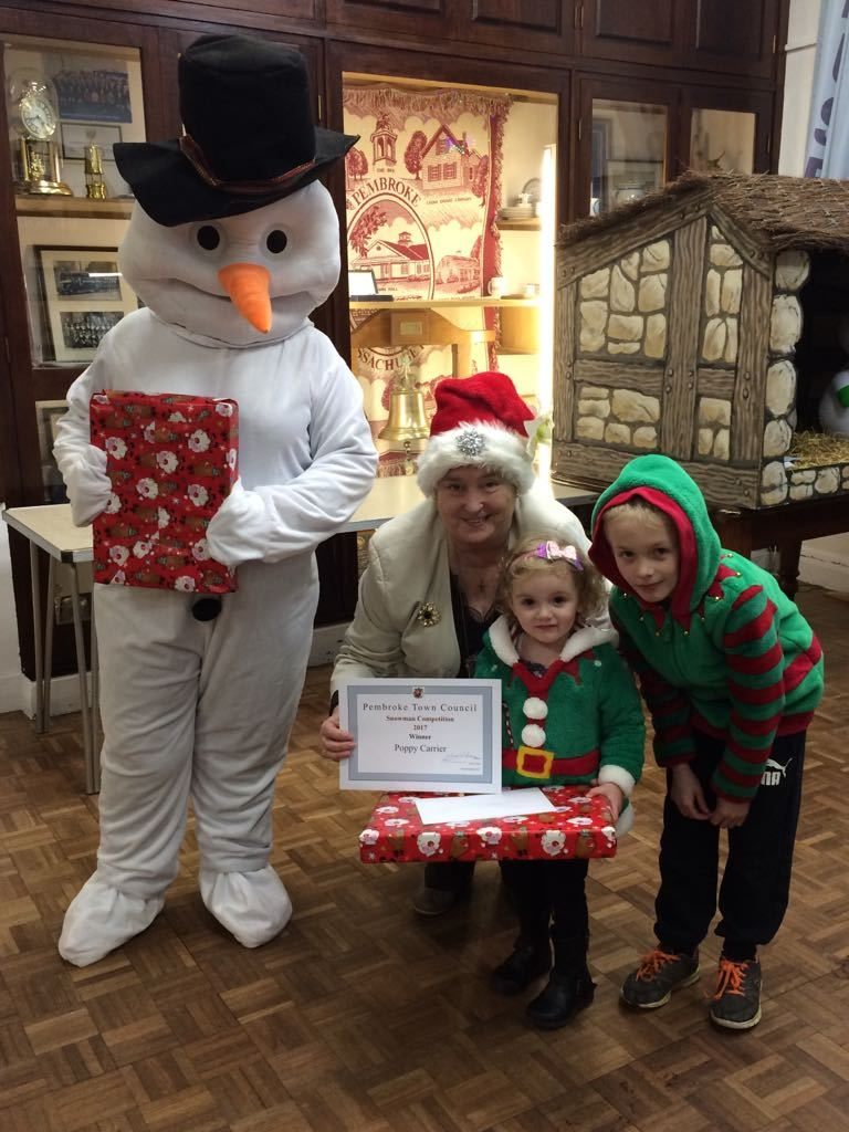 Poppy and Kasen Carrier, are pictured being presented their prizes and certificates by the Deputy Mayor of Pembroke Cllr Linda Brown, along with Frosty the Snowman.