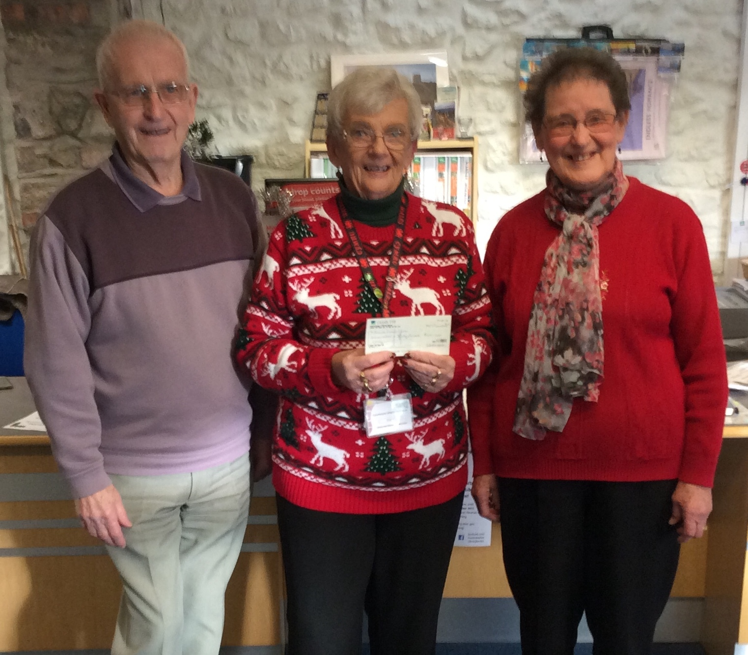 Pictured are Graham and Dot Roberts presenting a cheque for £140 to Sheila Ralph local volunteer for Breast Cancer Care.