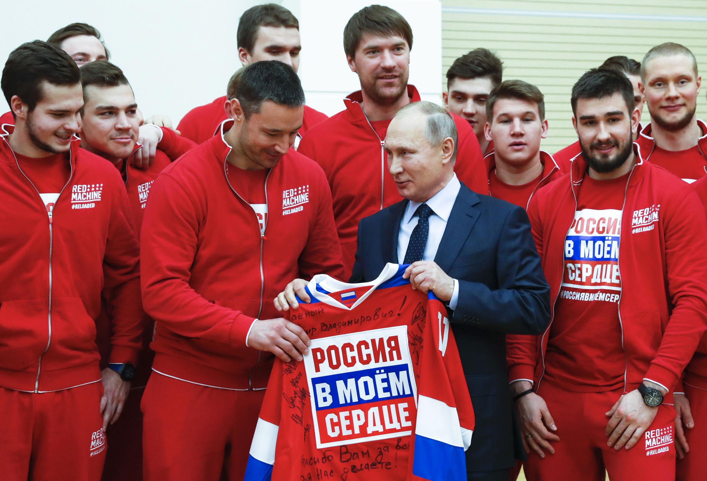Russian President Vladimir Putin, posing with the Russian national ice hockey team during a meeting with the Russian athletes who will take part in the upcoming 2018 Pyeongchang Winter Olympic Games. PICTURE: PA Wire.