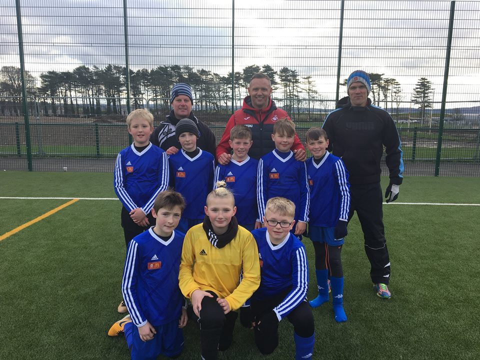 The Neyland Community School team with teacher Ricky Bowen and Lee Trundle at Coleg Sir Gar.