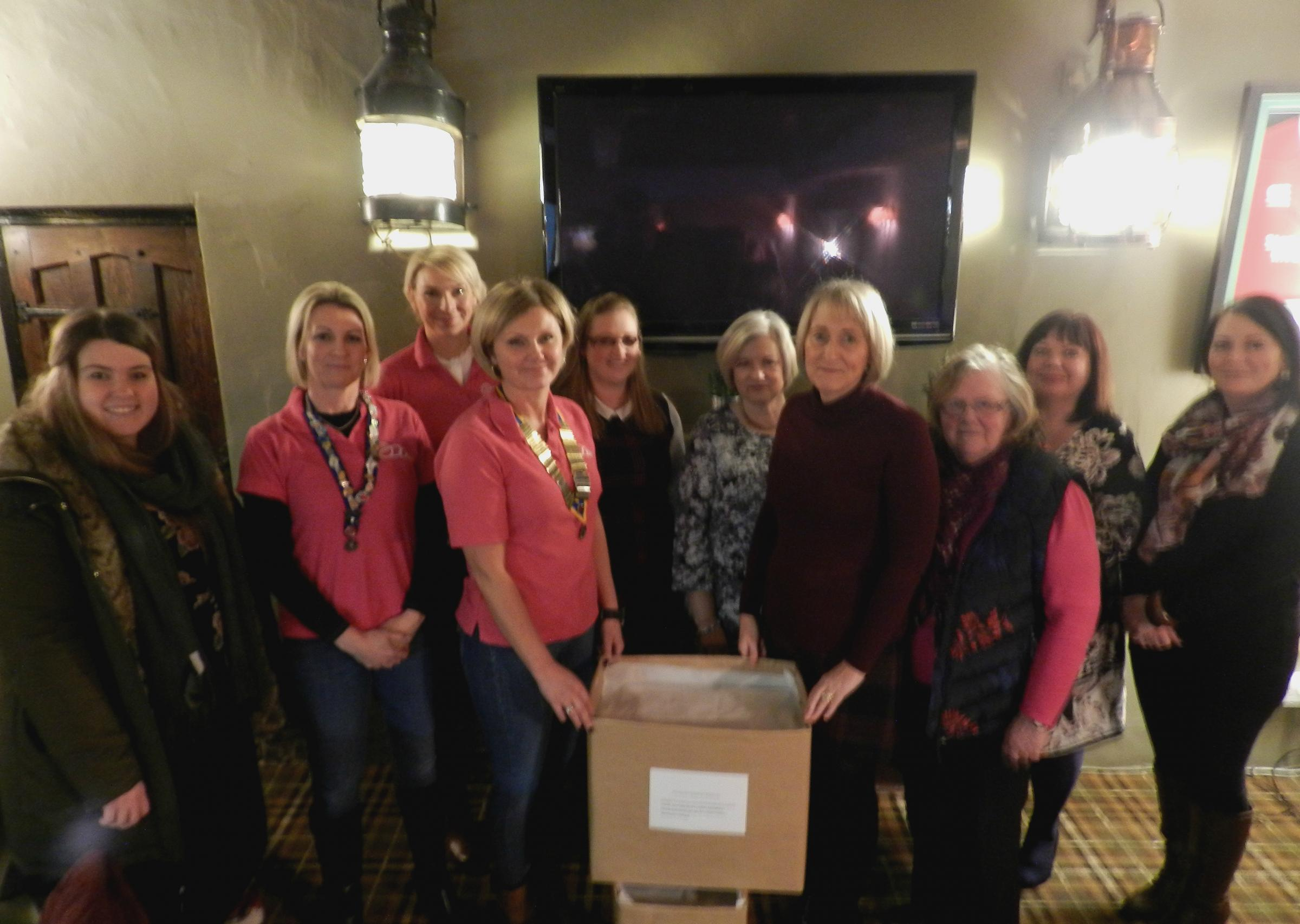 Members of Haverfordwest Ladies Circle with Homeless Pembrokeshire, as they hand over the sanitary product donation to PCC's housing team.