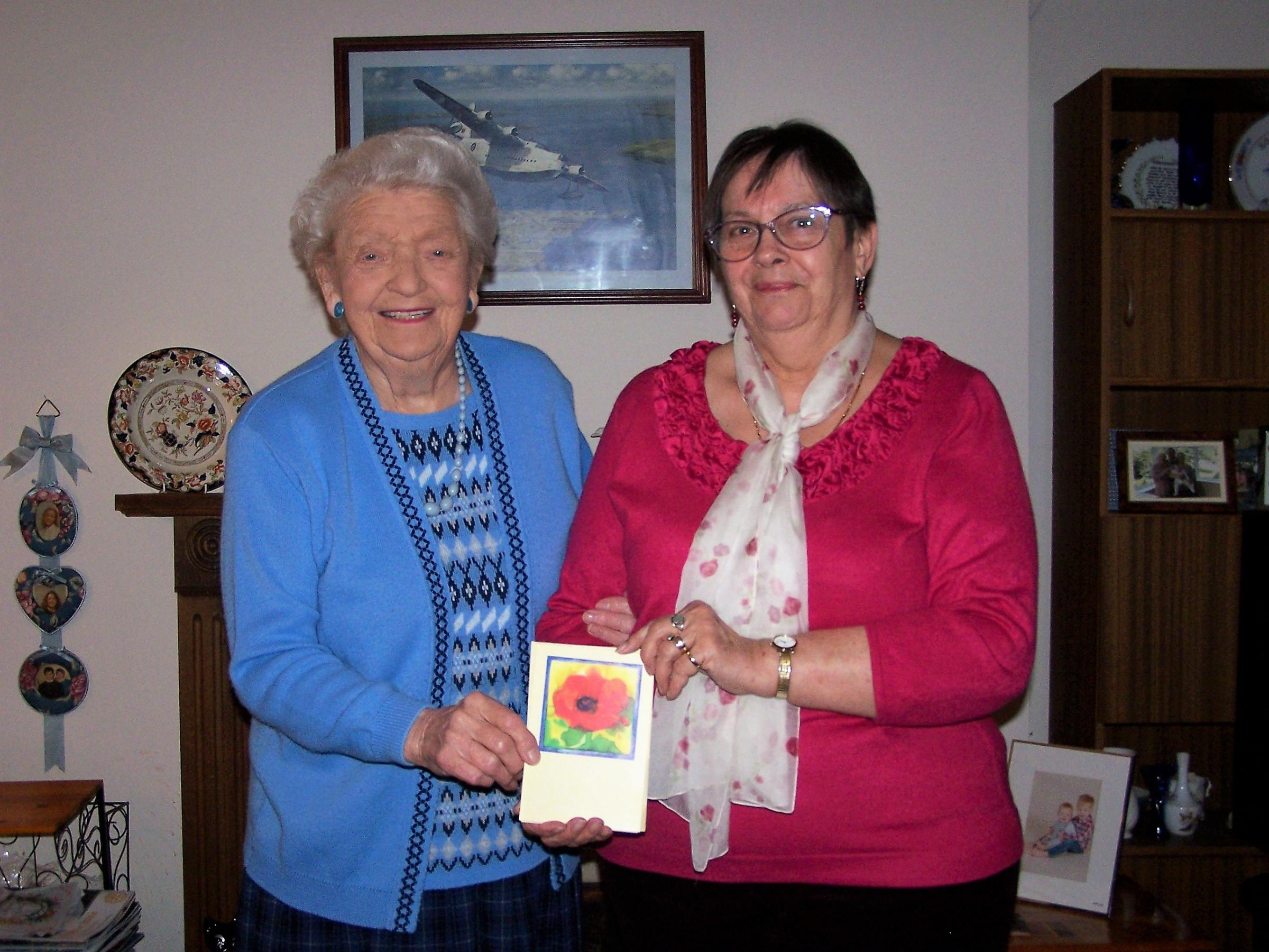 Marjorie Davies is pictured donating the cheque for £780 to Maimie Davis of the Motor Neurone Disease Association.