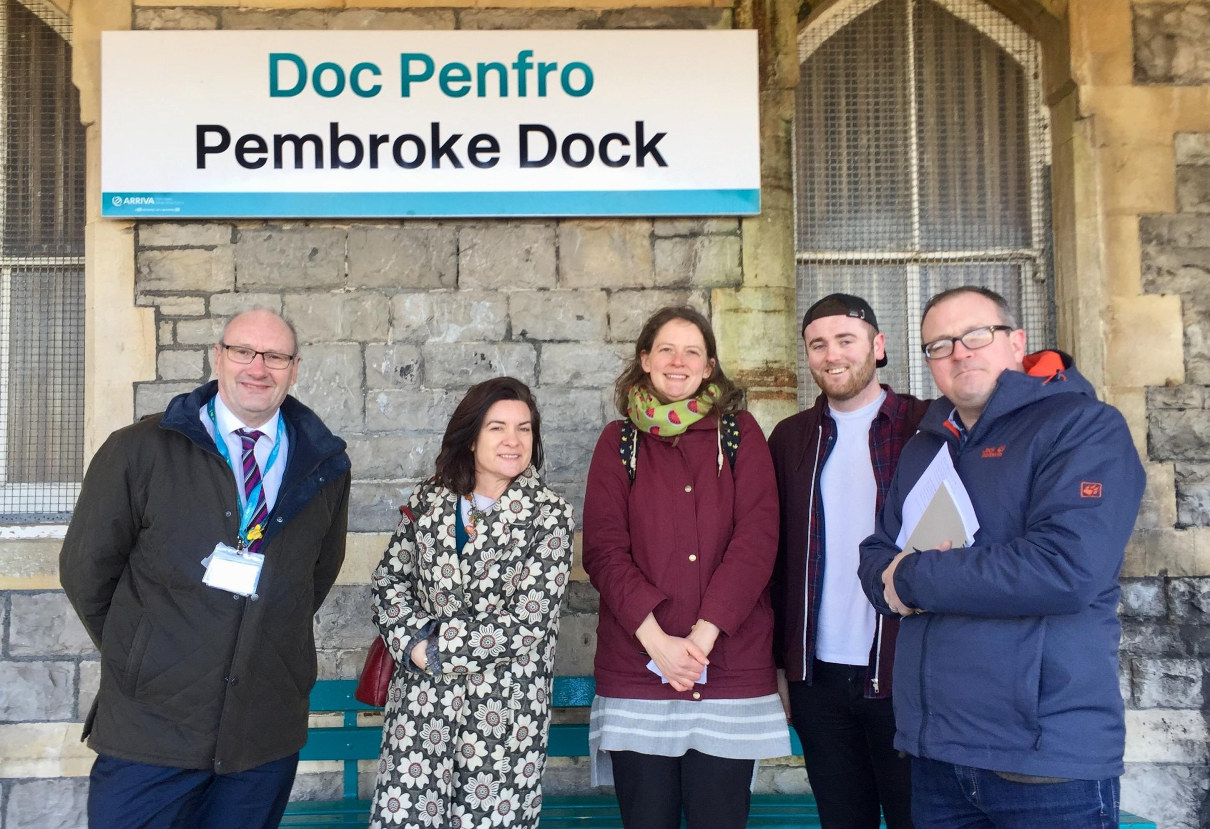 Arriva Trains Wales Manager Ben Davies is pictured with with Labour AM Eluned Morgan, Town Councillor Dilys Burrell, County Councillor Josh Beynon and Community campaigner, Marc Tierney at Pembroke Dock Railway Station.