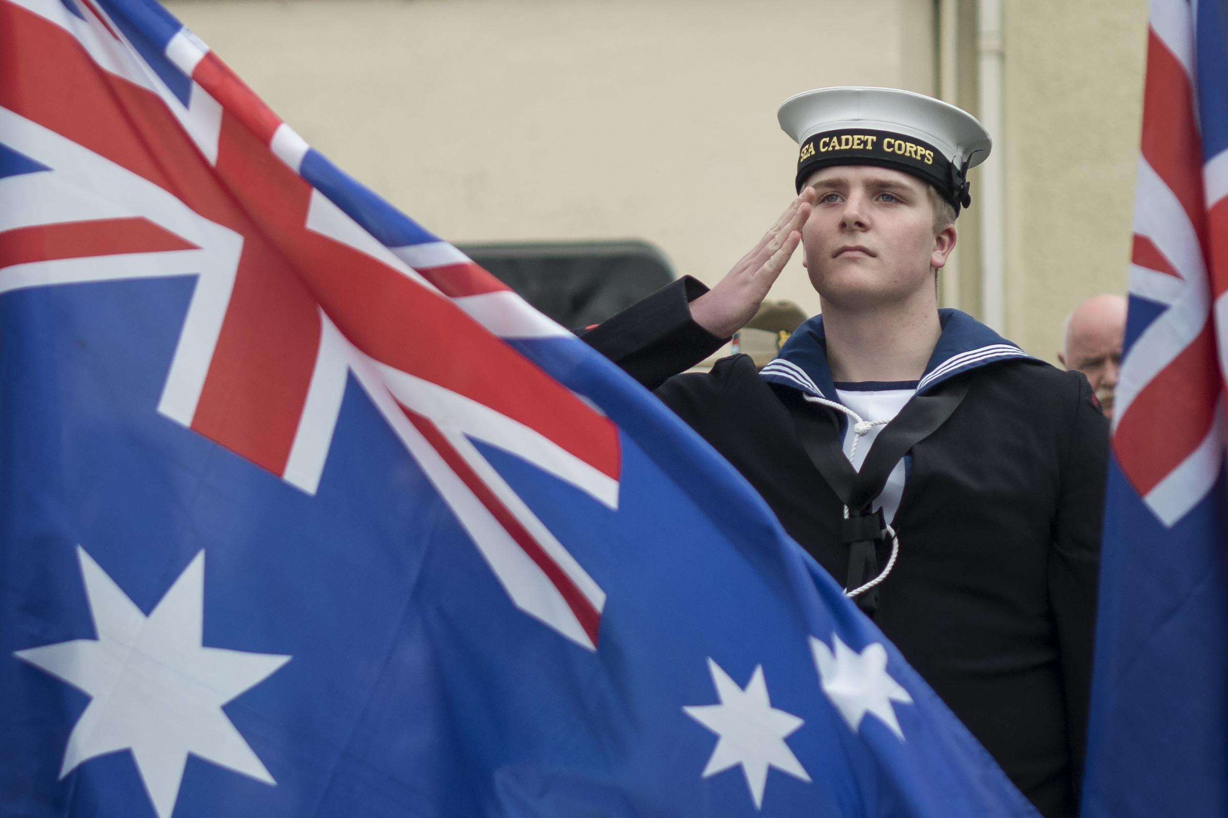 A cadet salutes after laying a wreath on Hamilton Terrace. PICTURE: Milford Mercury