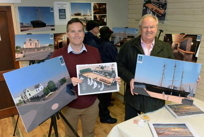 Saundersfoot Harbour chief executive Mike Davies and harbour commissioner Pip Parker are pictured with the visuals of the tall ship building, the completed decking and Ocean Square that can be seen at the exhibition. PICTURE: Gareth Davies Photography.