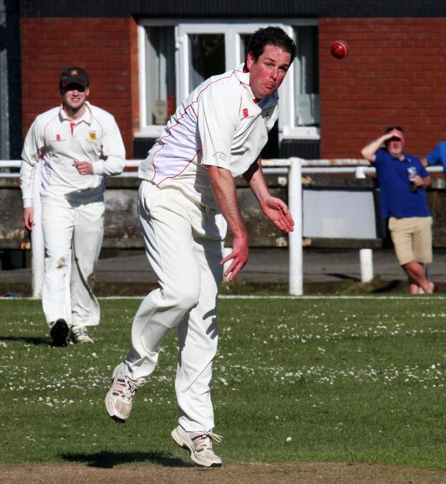 Rob Scourfield on his way to three wickets for Carew. PICTURE: Susan McKehon.