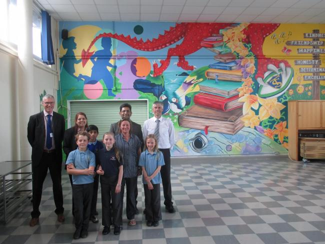 Pictured with the new Tavernspite School mural are governors' chair Nick Davies, Dr Faiz Ali and Dr Taher Ali, artist Martina Morgan, headteacher Kevin Phelps and pupils Ruben, Saski and Nia-Anne Morgan and Haroon Ali..