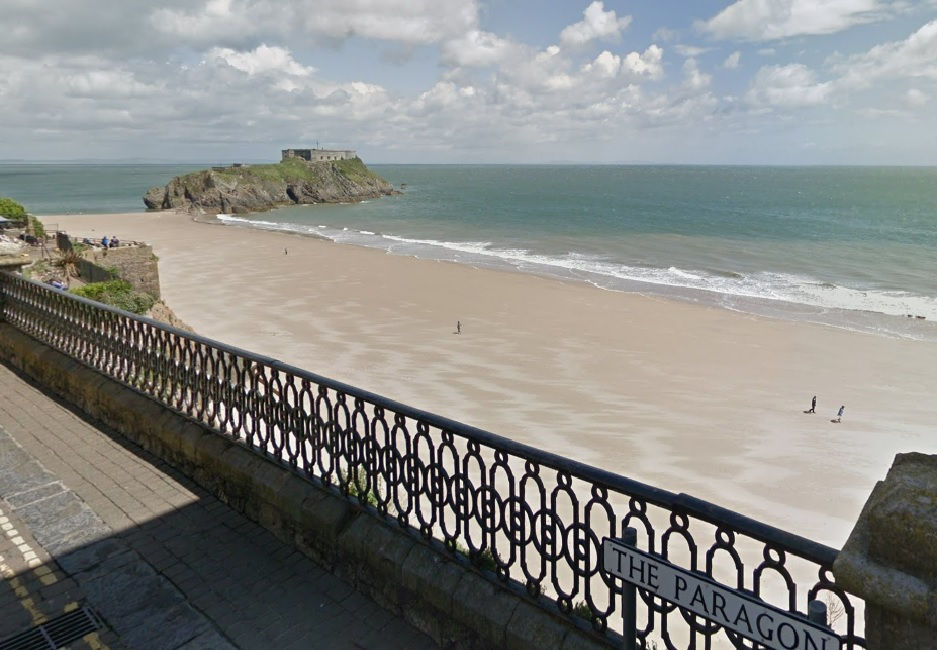 The 25-year-old woman was taken to hospital after falling 20 feet from The Paragon, above Tenby's South Beach.