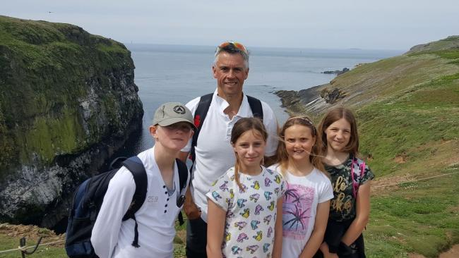 Tavernspite School's headteacher, Kevin Phelps, and Year 6 pupils enjoy the Skomer scenery on the annual school trip to the island..