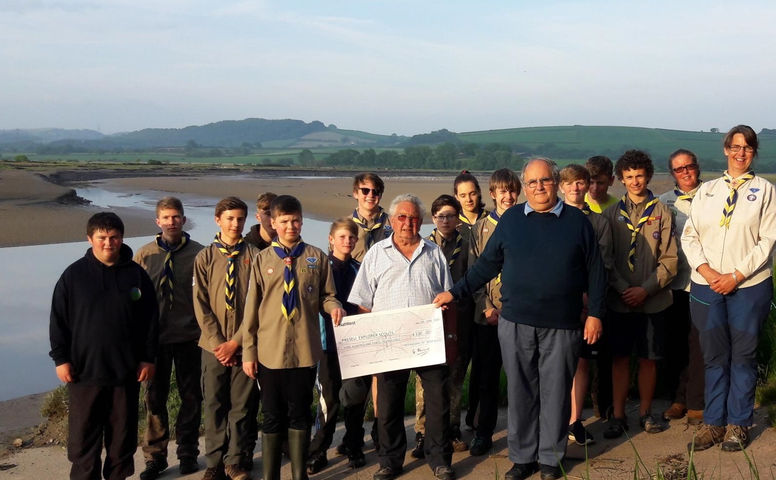 Preseli Pioneers Explorer Scout group members are pictured receiving the cheque from George Bancroft and Freemason Patrick of the Freemasons of West Wales.