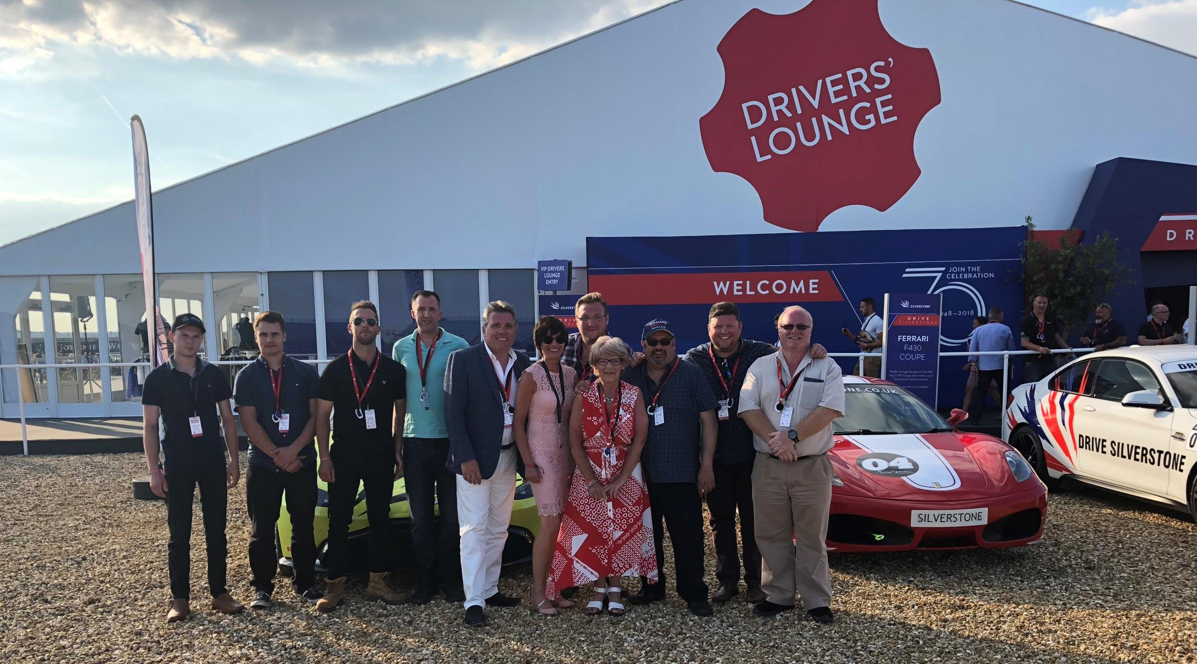 The Fred Rees Garages SKODA team members are pictured outside the Driver's Lounge at the F1 British Grand Prix at Silverstone.