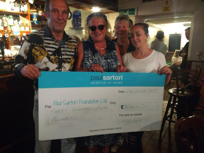 Pictured, from left: Quiz Master Dilwyn Davies, Natalie James, quiz writer Pam Protheroe, and landlady Charlie Jones.