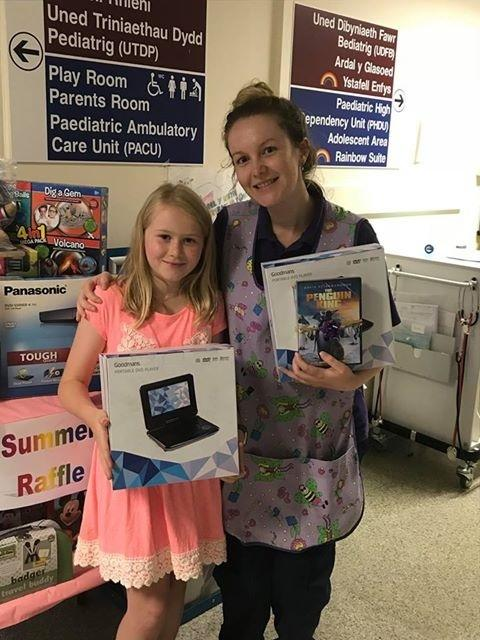 Abby's sunflowers helped buy DVD players for the children's ward.
