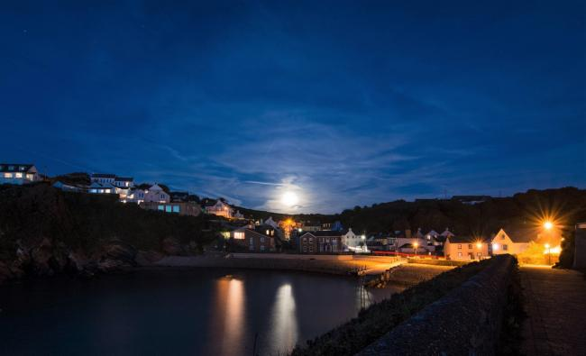 Harvest moon over Little Haven taken by Andrew Screwy Lewis