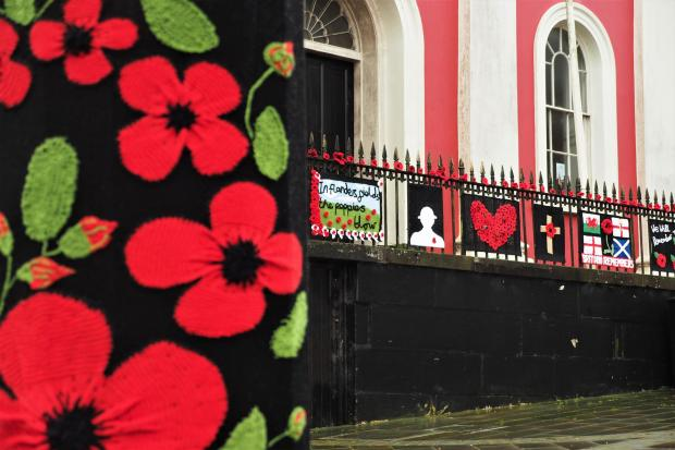 Western Telegraph: Haverfordwest's poppy 'yarn bomb'. PICTURE: Western Telegraph