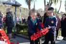 Youngsters from Tenby's Ysgol Hafan y Mor lay their school's poppy wreath. PICTURE: Gareth Davies Photography