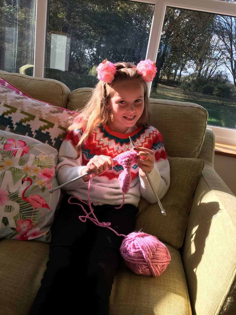 Freya Rands is knitting colourful hats, scarves, headbands and mittens in memory of her cousin Liam Jones.