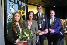 Eluned Morgan is pictured with head girl and head boy, Cerys Rees-Harries and Peter Richards with headteacher David Haynes.