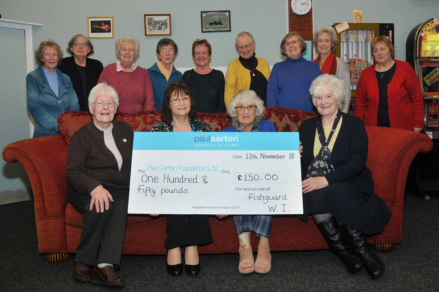 Members of Fishguard WI presenting Rosalind Raymond with the cheque.