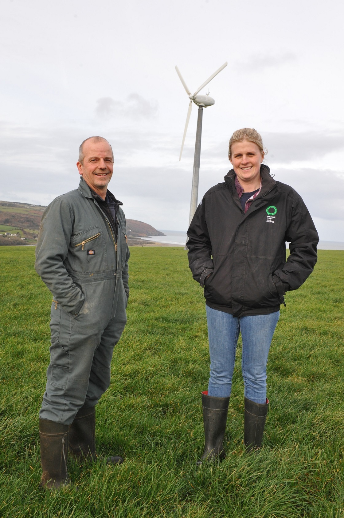 David Phillips, pictured with Abigail James of Farming Connect, has more than halved his energy costs with renewables PICTURE: Debbie James