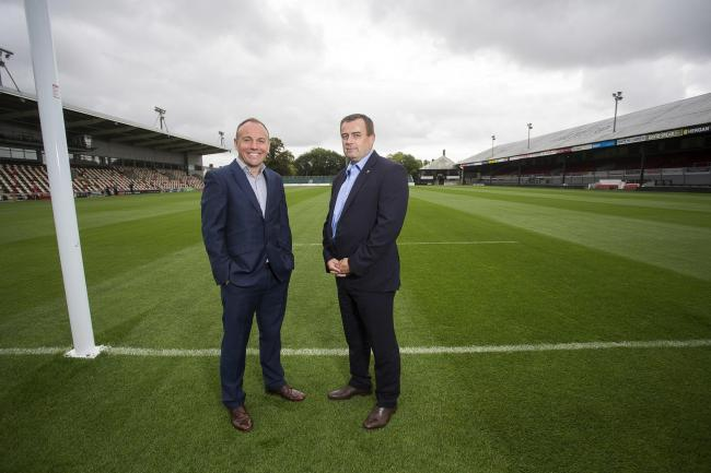 DELAY: Dragons chairman David Buttress, pictured with WRU chief executive Martyn Phillips, says a deal to take the region private won't happen this summer