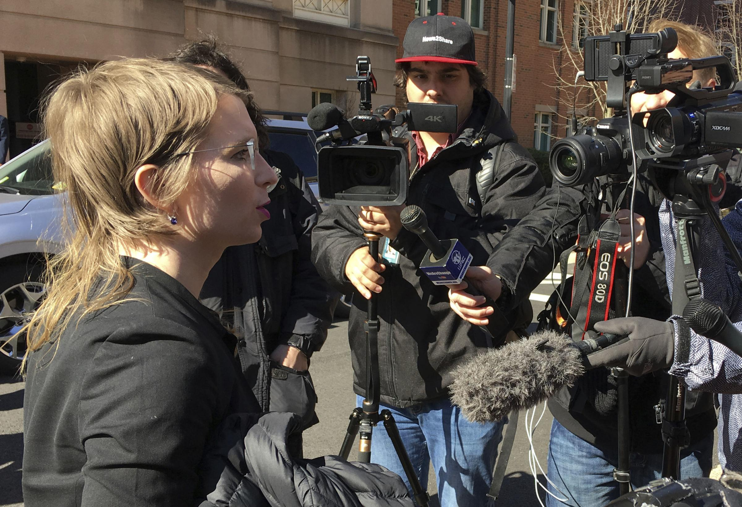 Chelsea Manning addresses the media outside federal court in Alexandria. AP Photo/Matthew Barakat