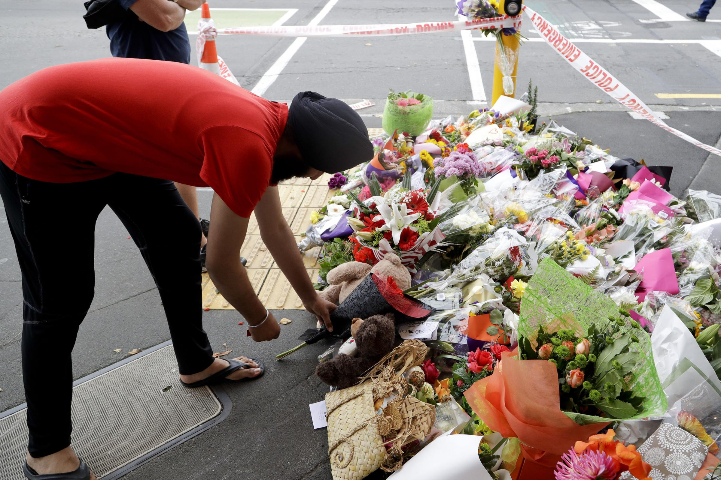 A man places flowers at a makeshift memorial near the Masjid Al Noor mosque in Christchurch, New Zealand, Saturday, March 16, 2019, where one of the two mass shootings occurred. PICTURE: Associated Press.
