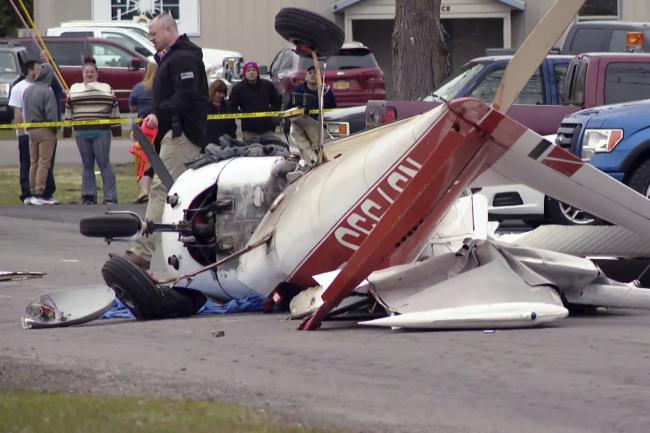 The wreckage of a light plane after it crash-landed on a street