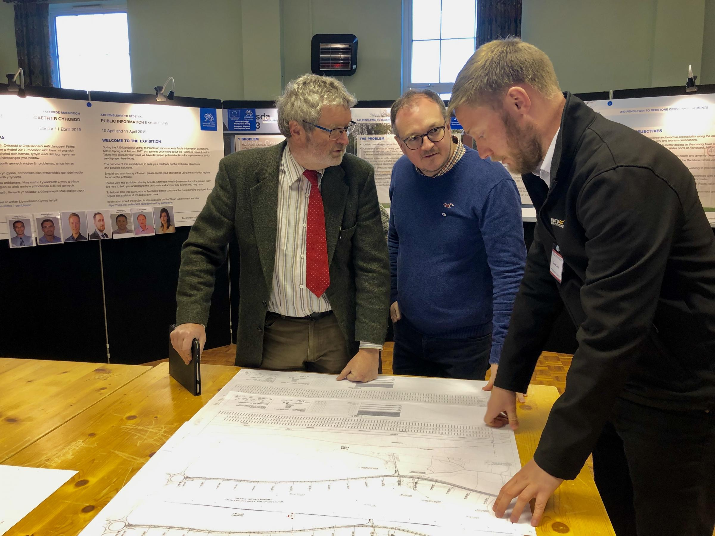 Cllr Vic Dennis and Marc Tierney viewing plans at the recent A40 Penblewin - Redstone Cross consultation event in Llanddewi Velfrey.